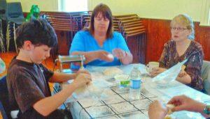 Brett Clayton, Janet Clayton and Kim Sauder get busy making ravioli!