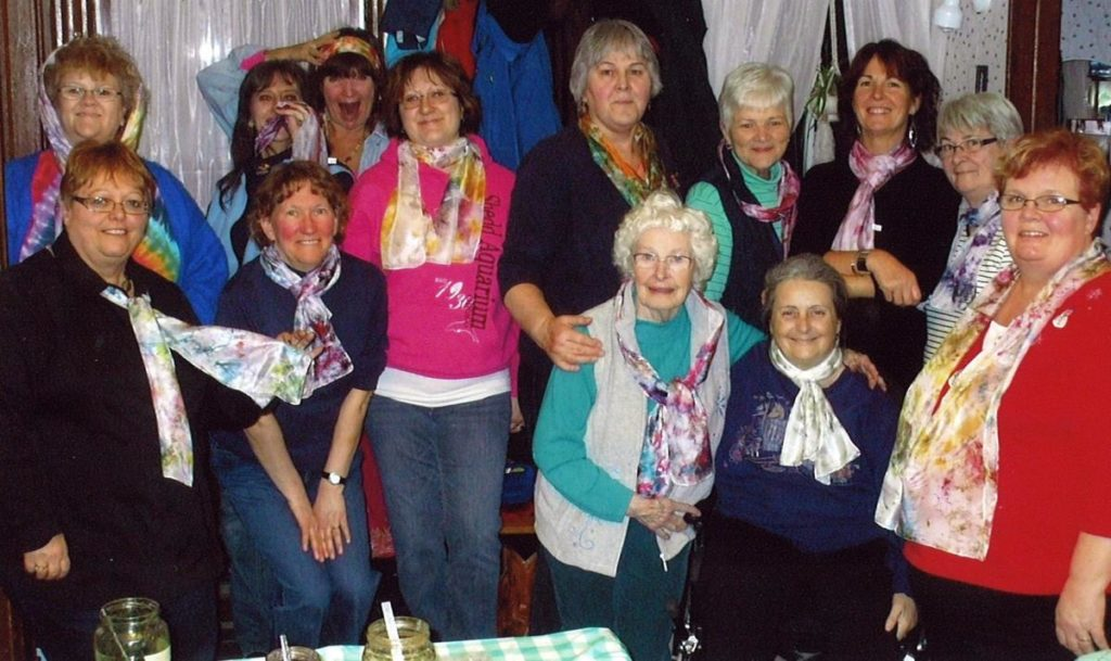 Pictured: Members and guests of Roebuck WI show off their brand new scarves!